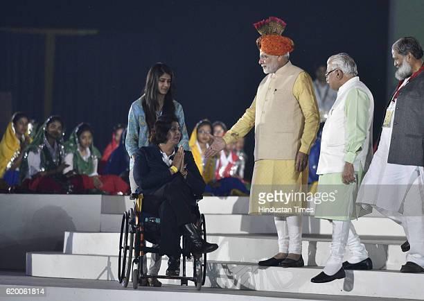 Prime Minister Narendra Modi presents 4 crore cheque to Rio Peraolympic Gold medalist Deepa Malik during the Haryana Swarna Jayanti Utsav celebration...