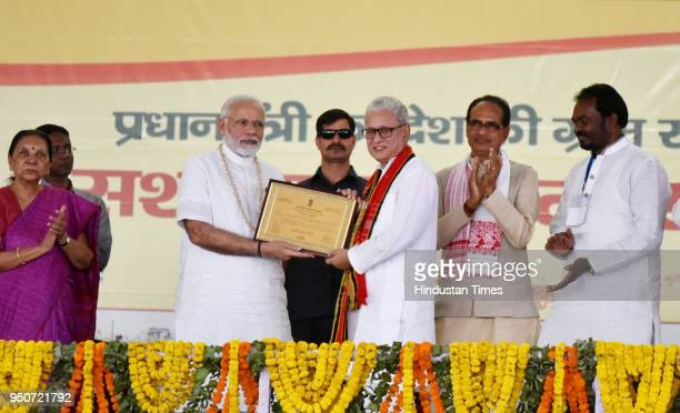 Prime Minister Narendra Modi presents ePanchayat award to Tripura deputy Chief Minister Jishnu Debbarma during the occasion of National Panchayati...