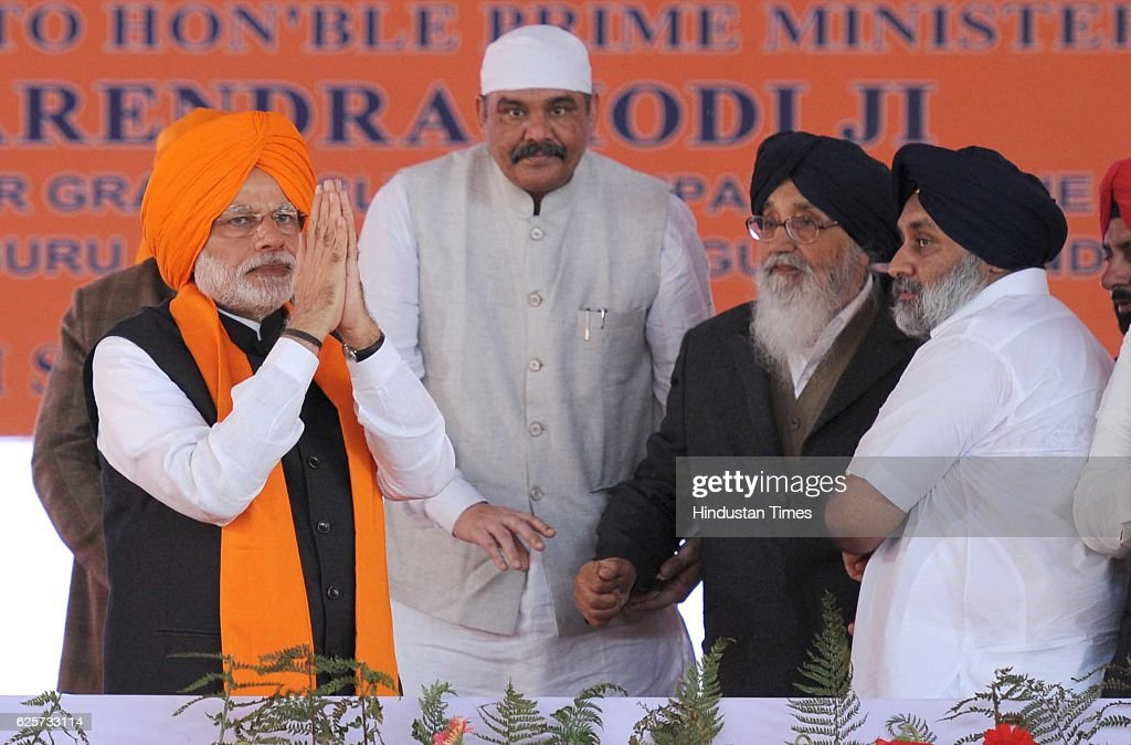 Prime Minister Narendra Modi Punjab CM Prakash Singh Badal and Punjab Deputy CM Sukhbir Badal and BJP leader Vijay Sampla during a function to mark...