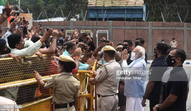 Prime Minister Narendra Modi received grand welcome by party leaders and workers on his returned at Palam Technical Area after concluding his...