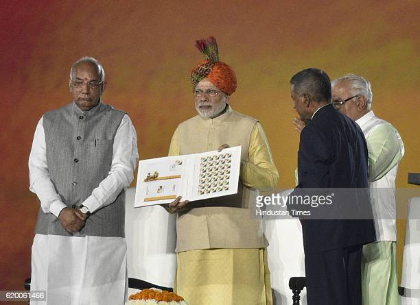 Prime Minister Narendra Modi releases postage stamp during the Haryana Swarna Jayanti Utsav celebration at Tau Devi Lal Stadium on November 1 2016 in...
