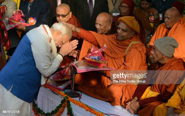 Prime Minister Narendra Modi seeks blessings of Buddhist monks at a ceremony to pay homage to Babasaheb Dr BR Ambedkar on his 62nd Mahaparinirvan...