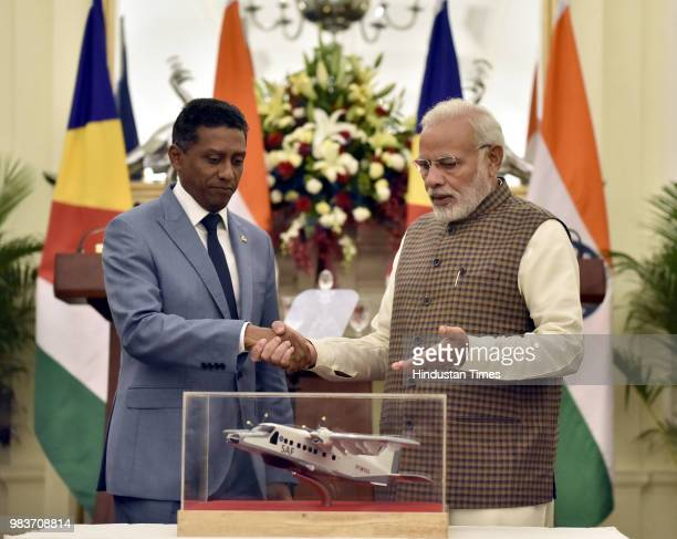 Prime Minister Narendra Modi shakes hand after handing over the replica of Dornier Aircraft to President of Seychelles Danny Antoine Rollen Faure...
