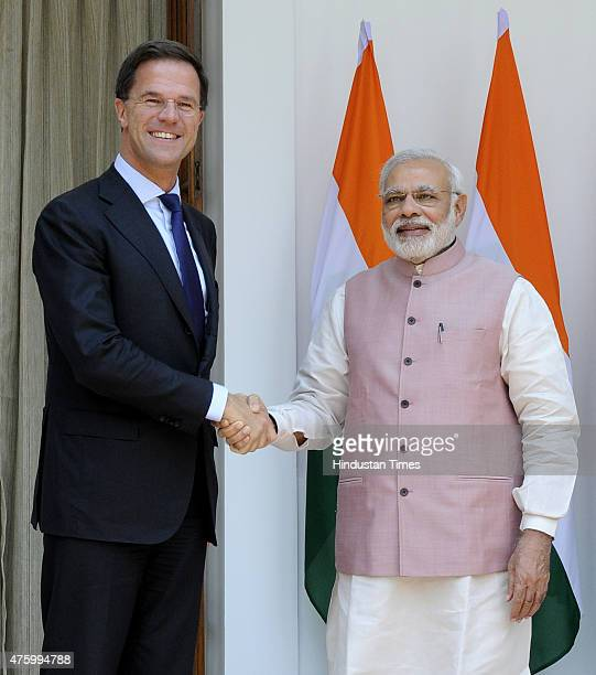 Prime Minister Narendra Modi shakes hands with his Netherland counterpart Mark Rutte before a meeting at Hyderabad House on June 5 2015 in New Delhi...
