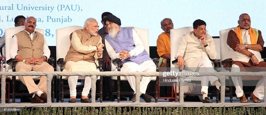 Prime Minister Narendra Modi sharing some words with Punjab CM Parkash Singh Badal during a function at PAU on October 18 2016 in Ludhiana India