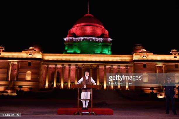 Prime Minister Narendra Modi speaks to media, after meeting with President to stake claim to form the government, at Rashtrapati Bhawan in New Delhi,...