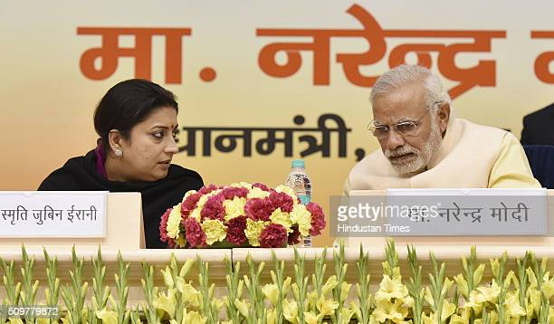 Prime Minister Narendra Modi talking to HRD Minister Smriti Irani during the Akhil Bharatiya Prachaarya Sammelan organized by the Vidya Bharati Akhil...