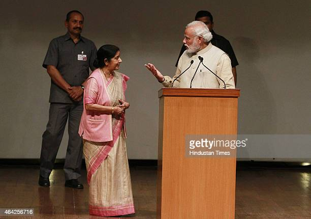 Prime Minister Narendra Modi talking with External Minister Sushma Swaraj at the inauguration of International Ramayana Mela at FICCI Auditorium on...