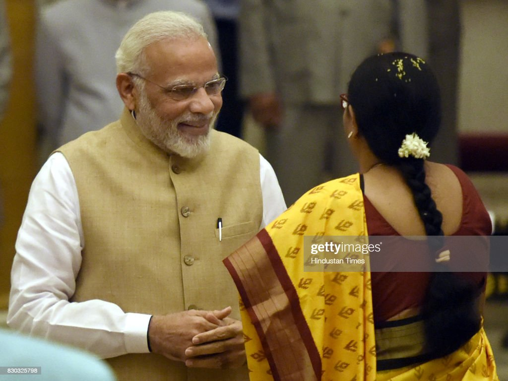 Prime Minister Narendra Modi talking with Usha Venkaiah Naidu during the 13th VicePresident of India sworn ceremony by M Venkaiah Naidu at Darbar...