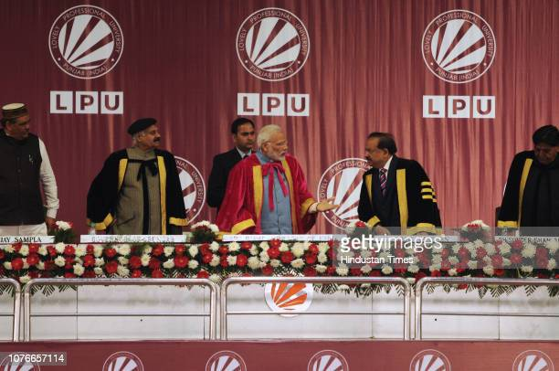 Prime Minister Narendra Modi talks to Minister of Science and Technology Harsh Vardhan during the inauguration of 106th Indian Science Congress at...
