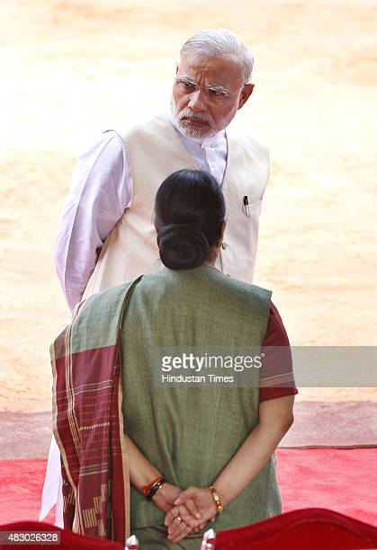 Prime Minister Narendra Modi talks with External Affairs Minister Sushma Swaraj prior to a ceremonial reception of President of the Republic of...