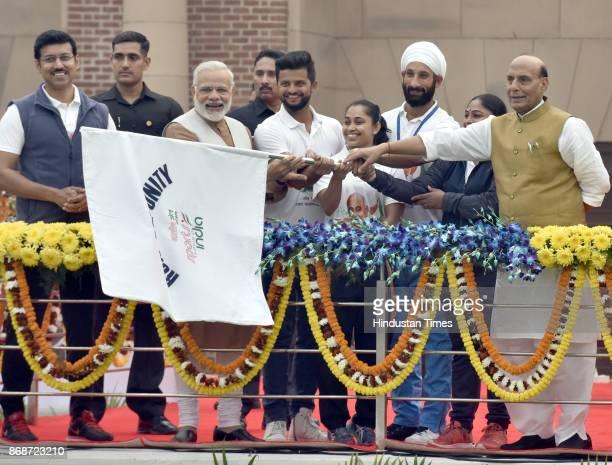 Prime Minister Narendra Modi Union Home Minister Rajnath Singh Union sports minister Rajyavardhan Singh Rathore and other sports person flag off the...
