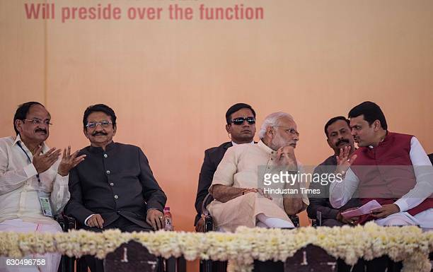 Prime Minister Narendra Modi Urban Development Minister M Venkaiah Naidu and Maharashtra Chief Minister Devendra Fadnavis at the foundation stone...
