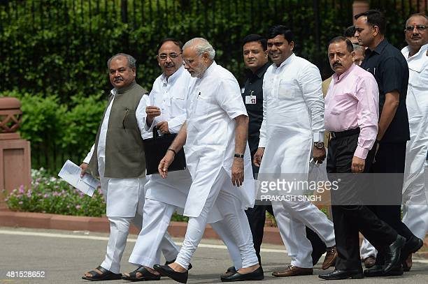 Prime Minister Narendra Modi walks out with Bhartiya Janata Party MPs after the BJP parliamentary committee meeting at the parliament building in New...