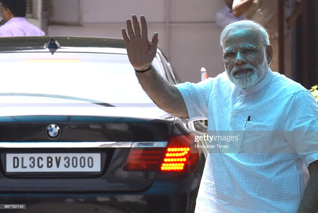 Prime Minister Narendra Modi waves after the party's Parliamentary Board meeting to announce their Presidential candidate, on June 19, 2017 in New Delhi, India. Bihar Governor Ramnath Kovind was named as NDA's nominee for presidential poll.