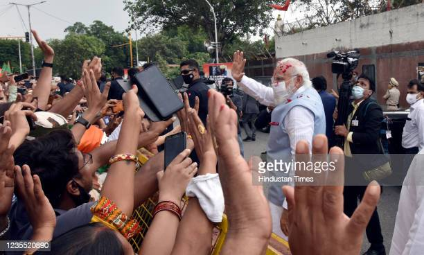 Prime Minister Narendra Modi waves at supporters upon his arrival from the US, at Palam technical Airport, on September 26, 2021 in New Delhi, India....