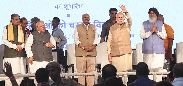Prime Minister Narendra Modi waves to the crowd during a function at PAU on October 18 2016 in Ludhiana India