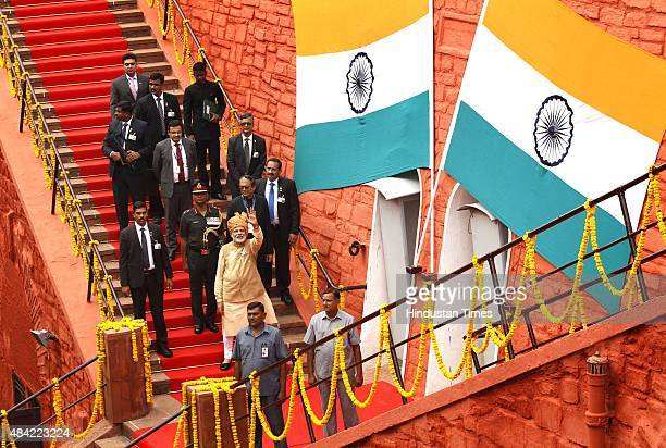 Prime Minister Narendra Modi waves to the media persons while he was leaving after addressing the nation from the ramparts of the Red Fort on the...