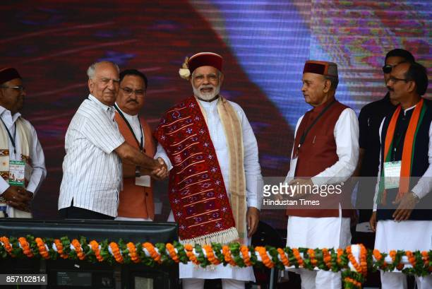 Prime Minister Narendra Modi welcomed by BJP's senior leader Shanta Kumar during a BJP Abhar Rally at Luhnu ground on October 3 2017 in Bilaspur...