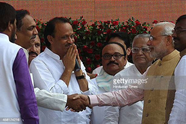 Prime Minister Narendra Modi welcomed by former deputy chief minister of Maharashtra Ajit Pawar and other NCP leaders during the swearingin ceremony...