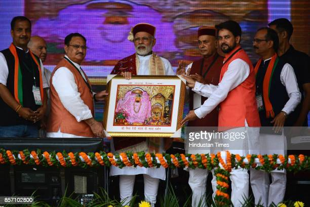 Prime Minister Narendra Modi welcomed by leaders during a BJP Abhar Rally at Luhnu ground on October 3 2017 in Bilaspur India PM Modi who was in...