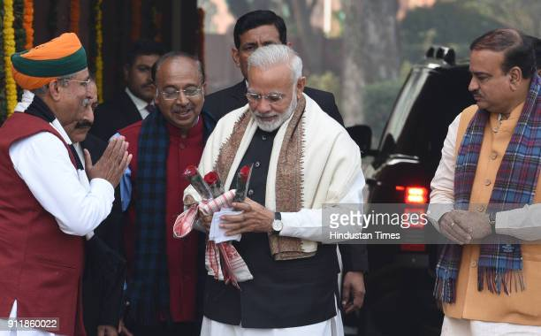 Prime Minister Narendra Modi welcomed by Union Parliamentary Affairs Minister Ananth Kumar Minister of State Arjun Ram Meghwal and Vijay Goel as he...