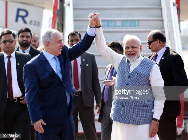 Prime Minister Narendra Modi welcomes Israeli Prime Minister Benjamin Netanyahu on his arrival at the Air Force Palam airport Station on January 14...