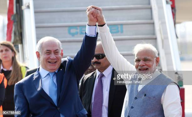 Prime Minister Narendra Modi welcomes Israeli Prime Minister Benjamin Netanyahu on their arrival at the Air Force Palam airport Station on January 14...