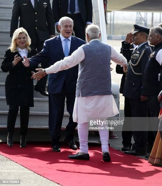 Prime Minister Narendra Modi welcomes Israeli Prime Minister Benjamin Netanyahu and his wife Sara Netanyahu on their arrival at the Air Force Palam...