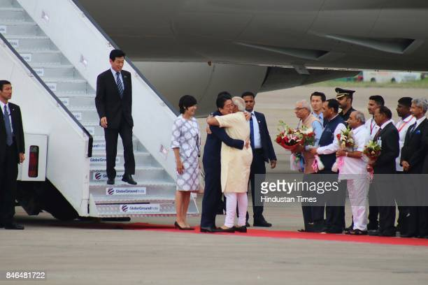 Prime Minister Narendra Modi welcomes Japanese Prime Minister Shinzo Abe upon his arrival at airport on September 13 2017 in Ahmadabad India Japanese...