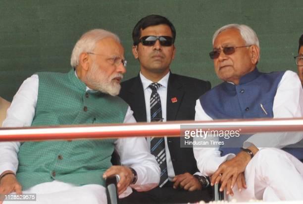 Prime Minister Narendra Modi with Bihar Chief Minister Nitish Kumar during Sankalp Rally at Gandhi Maidan on March 3 2019 in Patna India Modi while...