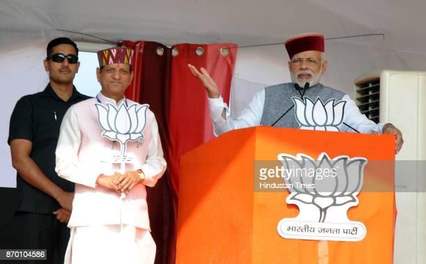 Prime Minister Narendra Modi with BJP candidate Kishan Kapoor during a BJP Parivartan Rally at Rait on November 4 2017 in Dharamsala India PM Modi...