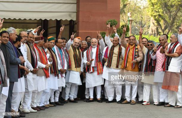 Prime Minister Narendra Modi with BJP leaders Amit Shah Rajnath Singh Vijay Goel Ananth Kumar and other cabinet ministers pose for a photograph after...