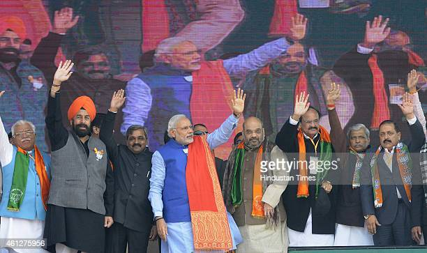 Prime Minister Narendra Modi with BJP president Amit Shah and BJP seniors leaders Satish Upadhyay Vijay Goel Harsh Vardhan and others during the...