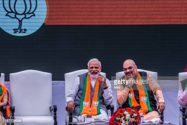 Prime Minister Narendra Modi with BJP president Amit Shah during the launch of BJP's election manifesto for the upcoming parliamentary elections on...