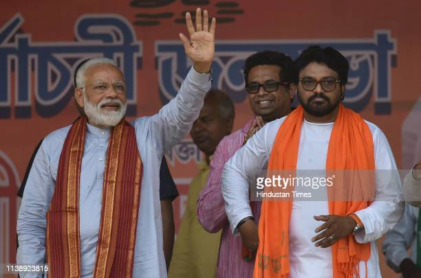 Prime Minister Narendra Modi with BJP's Asansol Lok Sabha candidate Babul Supriyo during an election campaign rally, at Asansol Polo ground, on April...