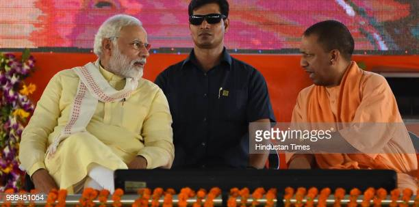 Prime Minister Narendra Modi with Chief Minister Yogi Adityanath during a public rally at Rajatalab Kachnar area on July 14 2018 in Varanasi India...