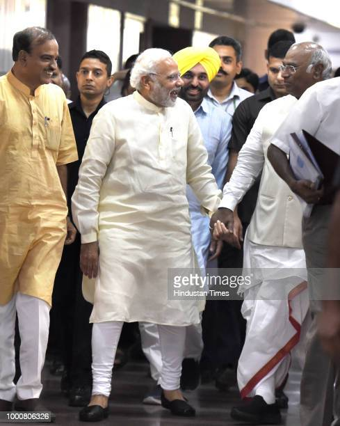 Prime Minister Narendra Modi with Congress Parliamentary Party leader Mallikarjun Kharge and Union Minister Ananth Kumar after an allparty meeting...