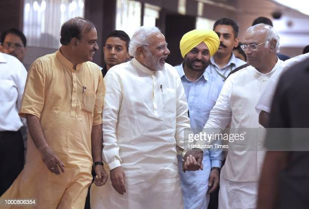 Prime Minister Narendra Modi with Congress Parliamentary Party leader Mallikarjun Kharge and Union Minister Ananth kumar after at an allparty meeting...
