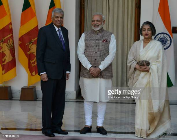 Prime Minister Narendra Modi with his Sri Lankan counterpart Ranil Wickremesinghe and his wife Maithree Wickramasinghe before a meeting at Hyderabad...