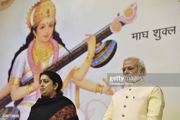 Prime Minister Narendra Modi with HRD Minister Smriti Irani during the Akhil Bharatiya Prachaarya Sammelan organized by the Vidya Bharati Akhil...