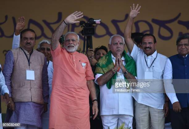 Prime Minister Narendra Modi with Karnataka State President and BJP chief ministerial candidate for upcoming state assembly election B S Yeddyurappa...