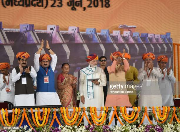 Prime Minister Narendra Modi with Madhya Pradesh Governor Anandi Ben Patel Chief Minister Shivraj Singh Chouhan Water Resources Minister Narottam...