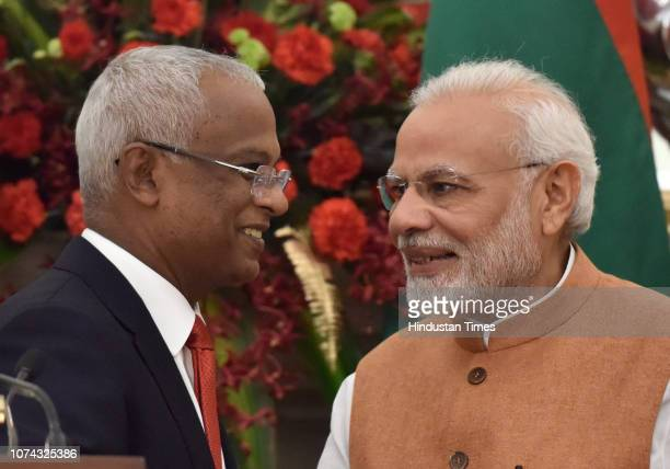 Prime Minister Narendra Modi with Maldivian President Ibrahim Mohamed Solih after delivering a joint press statement at Hyderabad House on December...