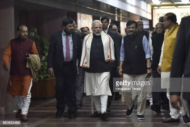 Prime Minister Narendra Modi with other leaders after attending an allparty meeting on the eve of the commencement of the winter session of...