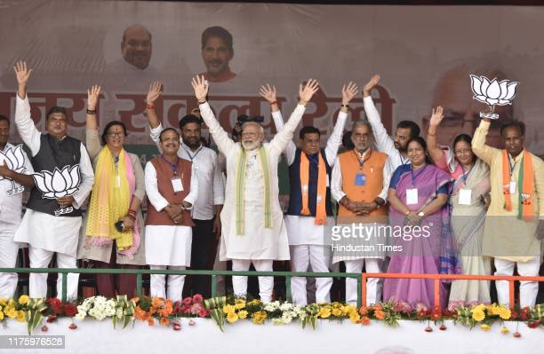 Prime Minister Narendra Modi with other party functionaries during a Vijay Sankalp Rally at Sector 61 on October 14, 2019 in Ballabgarh, India.