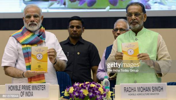 Prime Minister Narendra Modi with Union Minister for Agriculture and Farmers Welfare Radha Mohan Singh releases a book on Inamdar and Indian...