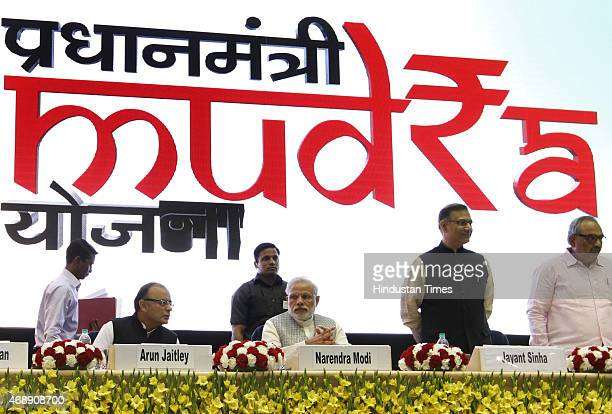 Prime Minister Narendra Modi with Union Minister for Finance Arun Jaitley and MOS Jayant Sinha during the launch of the Pradhan Mantri MUDRA Yojana...