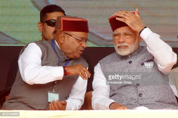 Prime Minister Narendra Modi with Union Minister Thawar Chand Gehlot during a BJP Parivartan Rally at Rait on November 4 2017 in Dharamsala India PM...