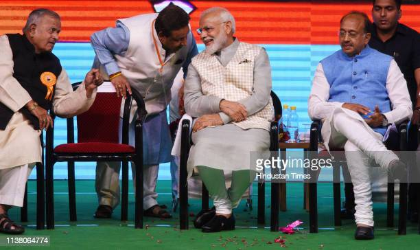 Prime Minister Narendra Modi with Union minister Vijay Goel and others during 'Traders Sammelan' at Talkatora Stadium on April 19 2019 in New Delhi...